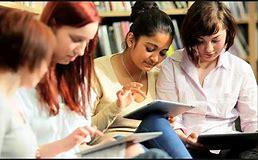 Teen girls doing schoolwork
