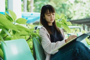Female student sitting with book